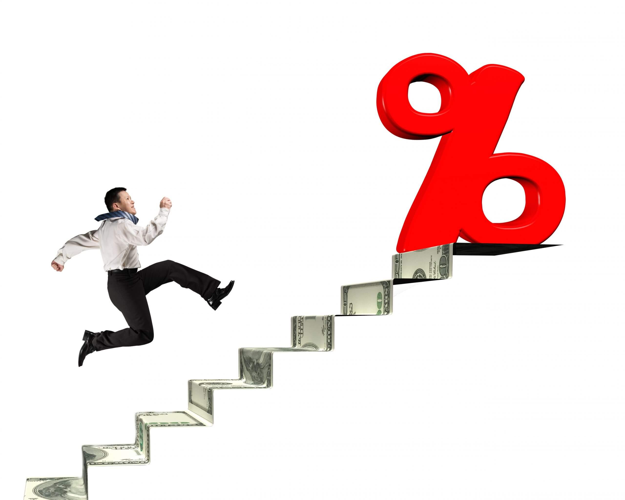 Image of man running up stairs made of a dollar bill with folds leading to a large percentage sign.