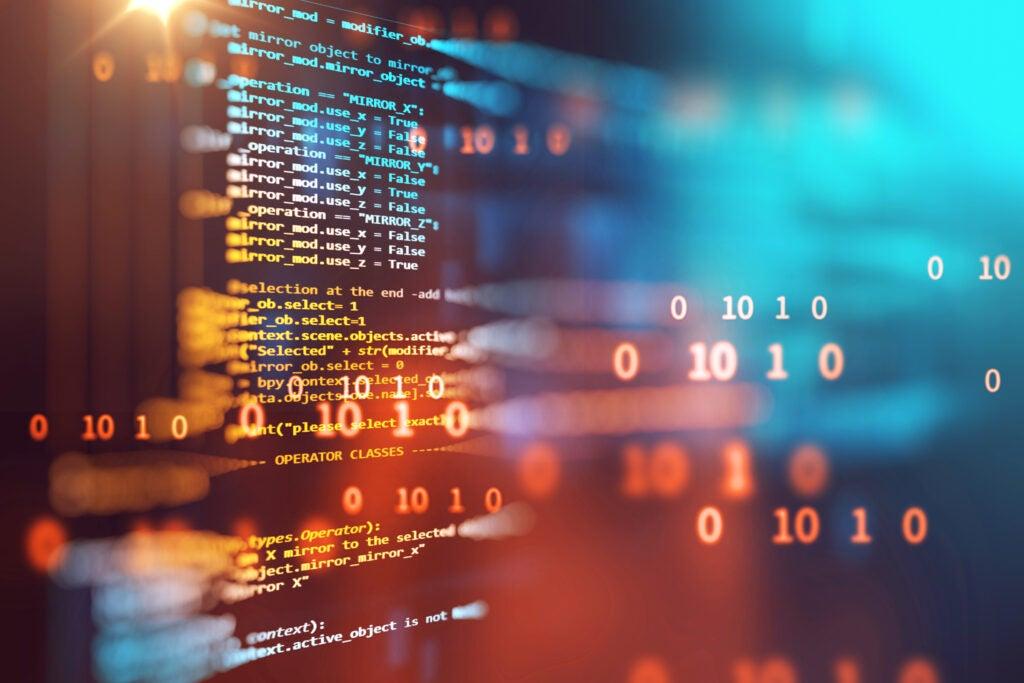 imagen que muestra el código en una pantalla y parte de él sale de la pantalla con un efecto 3D